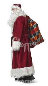 Santa Claus standing with a bag during Christmas