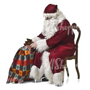 Santa Claus with a bag of gifts sitting on a chair