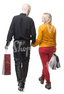 couple with shopping bags walking hand in hand