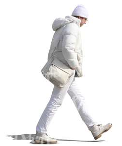 man in white winter clothes walking