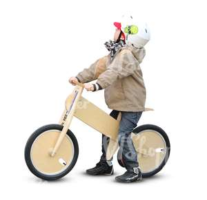 young child riding a likebike