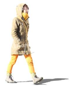 woman in yellow pants walking hands in her pocket