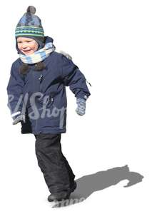 smiling boy running in winter clothes