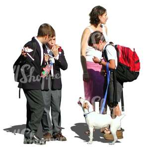 group of three schoolboys a woman and a dog standing together