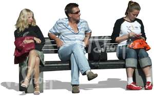 three people sitting on a bench