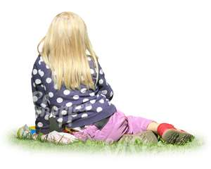 blond young girl sitting on the grass