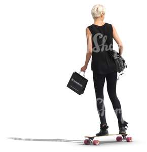 woman in a black outfit riding a skateboard
