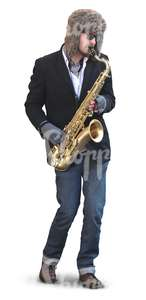man playing saxophone on the street during winter time