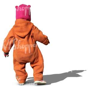child in an orange onsie walking