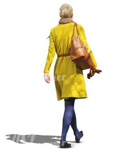 woman in a yellow coat walking