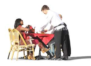 two people sitting in a street cafe with a waiter