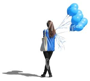 woman standing with a bunch of balloons