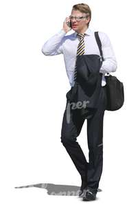 young businessman walking anf talking on his cellphone