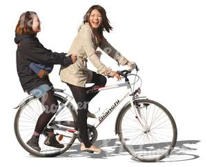 two laughing asian girls riding a bicycle