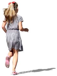 young girl in a striped dress running