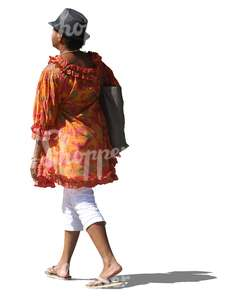 black woman with a hat and in a colorful blouse walking