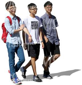 three asian boys smiling and walking