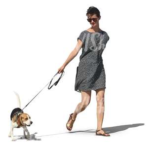 woman in grey dress walking a dog