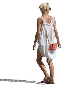 woman in a white dress walking