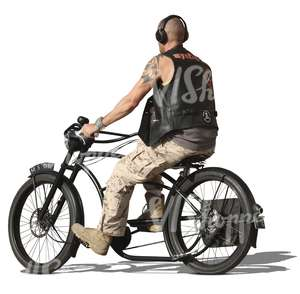 bald man riding a heavy bicycle