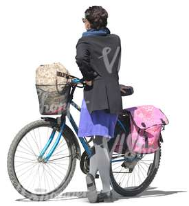woman standing next to her bicycle