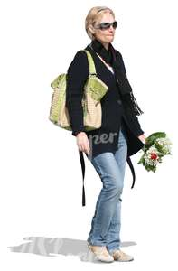 woman holding a bouquet of flowers walking