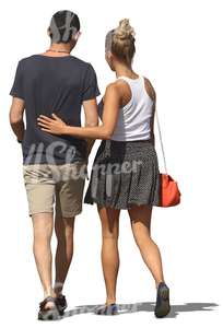man and woman walking with womans arm around him