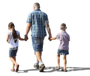 man walking with his two children hand in hand