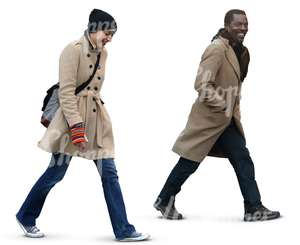 a man and a woman walking together and laughing