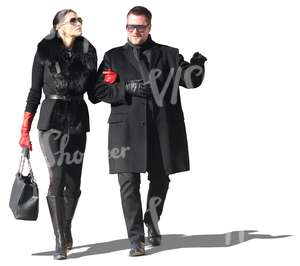 posh couple dressed in black walking arm in arm