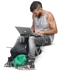 man sitting and working on his computer