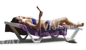 woman sunbathing on a beach chair