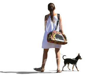 woman in a white dress walking a dog