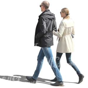 couple in spring coats walking arm in arm