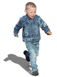 little boy in a denim outfit running around