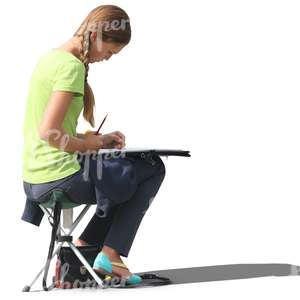 woman sitting on a stool and drawing