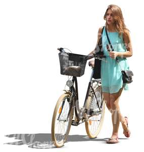 woman in a blue dress walking with a bicycle