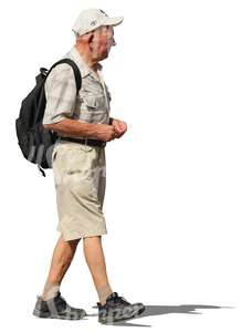 elderly man with a backpack walking