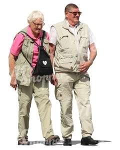 travelling elderly couple walking hand in hand