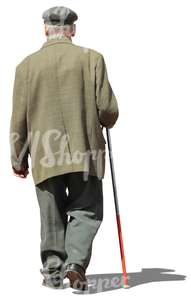 elderly man walking with a walking stick