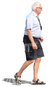 elderly man in shorts walking
