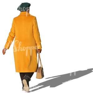 elderly woman in a yellow coat walking