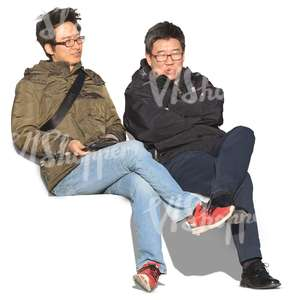 two asian men sitting and talking
