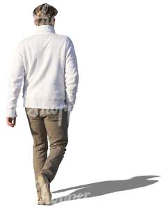 man in a white sweater walking