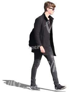 young man in black walking