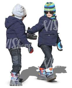 two kids in winter clothes walking