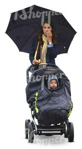 woman with an umbrella and a baby carriage walking in the rain
