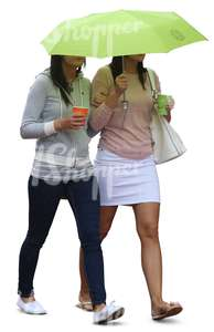 two women with an umbrella walking and drinking coffee
