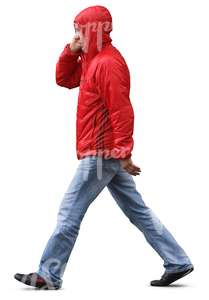 man in a red raincoat walking in the rain