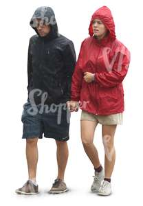 couple in raincoats walking hand in hand in the rain
